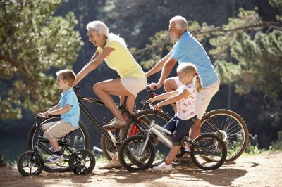 Senior,Couple,With,Grandchildren,On,Country,Bike,Ride